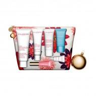 Souprava sdámskou kosmetikou Les Indispensables Week-end Essentials Clarins (7 pcs)
